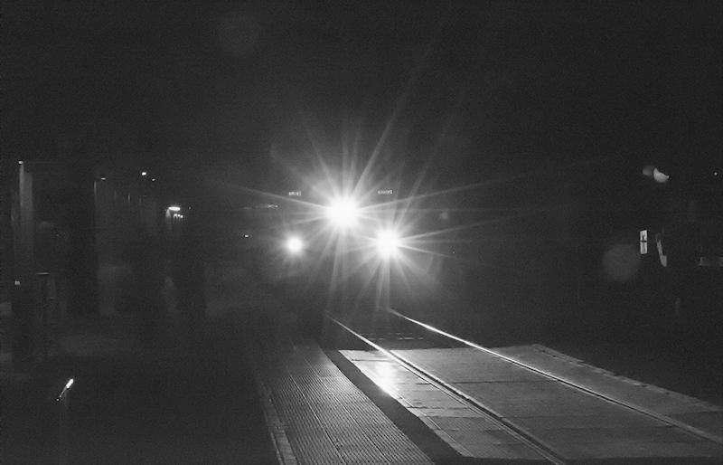 Night train approaching station